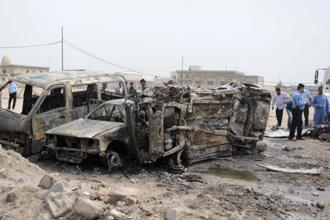 Police examine the wreckage after a car bomb exploded in Basra, 420km southeast of Baghdad on 17 March 2013. Photo: Reuters