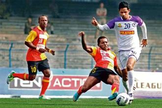East Bengal's Penn Orji tries to stop Prayag United's Asif K. as Chidi Edeh (No. 10) looks on. Photo: Courtesy Aiff Media.