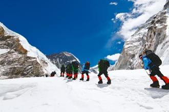 Climbers leave camp I (20,342ft) to trek across the Western Cwm, the large glacial valley between the Everest and its neighbouring peaks, Nuptse and Lhotse. The main challenge here is the intense heat of the sun reflected off the ice and snow. Photo: Percy Fernandez