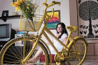 Founder Neha Arora with the symbol of her business, the yellow cycle, in Bangalore. Photo: Aniruddha Chowdhury/Mint