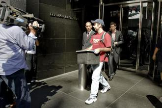 A 2008 photo of a man leaving the Lehman Brothers headquarters in New York after it filed for bankruptcy in 2008. Photo: Bloomberg