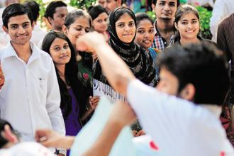 First-time voters listening to poll pitch at Zakir Husain Delhi College. Photographs: Priyanka Parashar/Mint