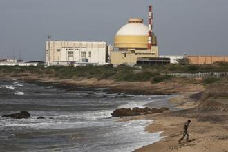 In a file photo a policeman walks on a beach near Kudankulam nuclear power project in the Tamil Nadu. Photo: Reuters