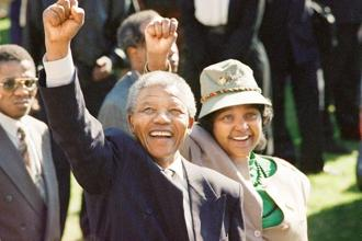 Nelson Mandela and his wife Winnie greet the crowd after arriving at a rally and week-long national ANC conference for the first time in 30 years, on 7 July 1991. Photo: John Parkin/AP