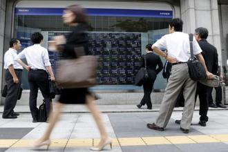 There is growing speculation that the Bank of Japan will announce a widening of its own stimulus programme launched in April as part of a drive to kick-start growth in the world's number three economy. Photo: Reuters