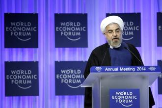 Hassan Rouhani, the first Iranian leader in a decade to attend the World Economic Forum (WEF) in Davos, is seeking investment to boost an economy battered by international sanctions imposed over Iran's nuclear work. Photo: Bloomberg