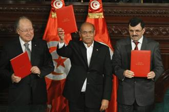 (Left to right) Tunisia's National Assembly president Mustapha Ben Jaafar, President Moncef Marzouki and outgoing Prime Minister Ali Larayedh pose after signing the country's new constitution in Tunis. Photo: Reuters