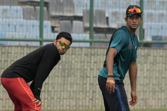 A file photo of Unmukt Chand (right) with Virat Kohli during a practice session at Ferozshah Kotla in New Delhi. Photo: Sunil Saxena/Hindustan Times