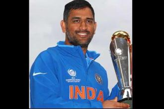 A file photo of Mahendra Singh Dhoni posing with the ICC Champions Trophy in Birmingham, England. Photo: Michael Steele/Getty Images