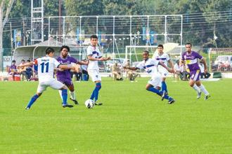 Bengaluru captain Chettri (extreme left) vies for the ball in an I-League match