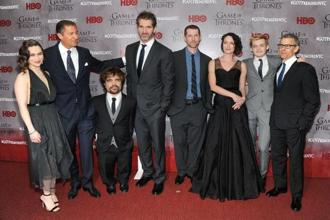 (L-R) Emilia Clarke, Richard Plepler, Peter Dinklage, David Benioff, D.B. Weiss, Lena Headey, Jack Gleeson and Michael Lombardo attend the 'Game Of Thrones' Season 4 premiere in New York on 18 March. Photo: AFP