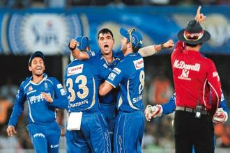 Pravin Tambe (centre), along with his Rajasthan Royals' teammates, celebrates the dismissal of a Kolkata Knight Riders player during an IPL match on 5 May. Vijayanand Gupta/Hindustan Times