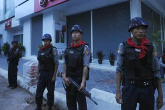 Myanmar police stand guard on a street in Mandalay in central Myanmar on Thursday. Photo: AFP