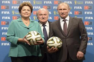 Vladimir Putin, Dilma Rousseff and Fifa president Sepp Blatter take part in the official hand over ceremony for the 2018 World Cup scheduled to take place in Russia. Photo: Reuters