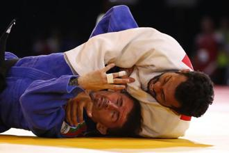 Navjot Chana of India (right) holds down Brandon Dodge of Wales during their men's 60kg judo quarterfinal bout at the Commonwealth Games on Thursday. Photo: AP