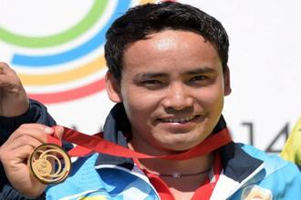 India's Jitu Rai celebrates after winning gold medal in the 50-metre pistol event during the Commonwealth Games in Glasgow on Monday. Photo: PTI