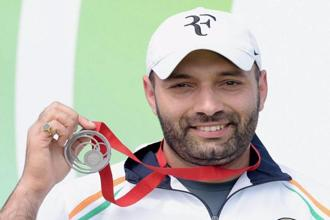 Silver medallist Harpreet Singh poses at the medal ceremony of the men's 25 metre rapid fire pistol event at the Commonwealth Games 2014 in Glasgow on Tuesday. Photo: PTI