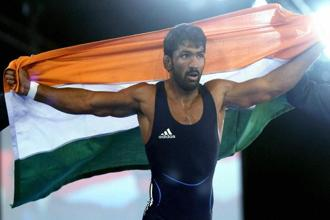 India's Yogeshwar Dutt celebrates after winning the gold medal against Canada's Jevon Balfour during the men's freestyle wrestling 65kg final match at the Commonwealth Games 2014 in Glasgow on Thursday. Photo: PTI