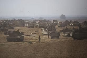 Israeli soldiers and tanks are seen at a staging area, near the border with the Gaza Strip. The enclave was quiet following days of Egyptian-brokered mediation to stem violence which has killed 1,940 Palestinians and 67 on the Israeli side since 8 July. Photo: Reuters