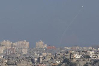 A smoke trail is seen as a rocket is launched from the Gaza Strip towards Israel on Wednesday. Photo: Reuters