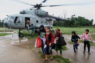 A flood-affected family after being rescued by the Indian Air Force in Jammu and Kashmir. Photo: PTI