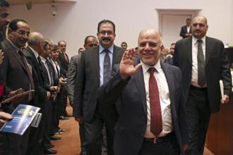 Iraq's new prime minister Haider al-Abadi (center) attends a parliament session to submit his government in Baghdad on Monday. Photo: Reuters