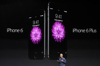 Tim Cook, chief executive officer (CEO) of Apple Inc., unveils the iPhone 6 and iPhone 6 Plus during a product announcement at Flint Centre in Cupertino, US, on Tuesday.