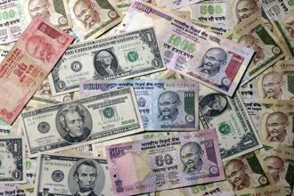 On Tuesday, before the US Federal Reserve was to start a two-day policy meeting, the rupee gained 0.14%. That gain came after data on Monday showed the trade deficit decreased to $10.8 billion in August, from $12.2 billion in July—the biggest drop in almost a year. Photo: Bloomberg
