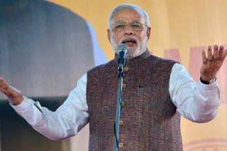 China's new decision coincides with the global launch of Prime Minister Narendra Modi's 'Make in India' campaign on Thursday. Photo: PTI