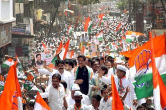 Congress candidate and former chief minister of Maharashtra Prithviraj Chavan on way to file his nomination papers from Karad (South) constituency in Karad, Maharashtra on Saturday. Photo: PTI