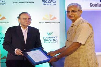 Hanumappa Sudarshan of Karuna Trust with Arun Jaitley on Tuesday. Photo: PTI