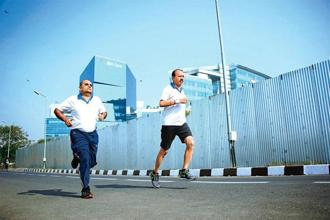 Sunil Fadia (left) and Mukesh Limbachia have had bypass surgeries and will be running the half marathon in Mumbai on Sunday. Photo: Devendra Parab/Mint