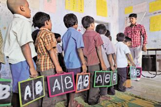 India's Right to Education (RTE Act) states that students have to be placed in age-appropriate classes despite having varied abilities—some are better at maths, others at languages. Photo: AFP