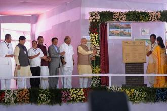 Prime Minister Narendra Modi (7th from left) laying foundation stone for a Centre of Excellence for Vegetable Production in Baramati on Saturday. NCP chief Sharad Pawar (6th from left) is also seen. Photo: PTI