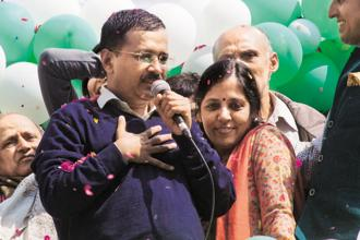 Arvind Kejriwal with his wife, Sunita, after the results of the Delhi elections were announced, in New Delhi. Photo: Sneha Srivastava/Mint