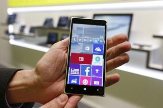 A Microsoft representative shows a Windows smartphone with Windows 10 operating system at the CeBIT trade fair in Hanover on 14 March 2015. Photo: Morris Mac Matzen/Reuters