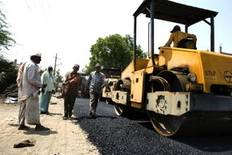 The government is trying to spend more on road-building and construction, which has been the main source of providing jobs to unskilled workers coming from farms. Photo: Mint