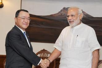 Prime minister Narendra Modi with Japan's minister for economy, trade and industry, Yoichi Miyazawa in New Delhi on Wednesday. Photo: PTI