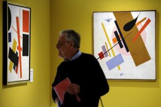 "A visitor walks by ""Suprematism"" by Russian artist Kazimir Malevich. In 2008 an avant-garde piece by Kazimir Malevich went for $60 million at a Sotheby's sale in New York, a record price for a Russian work of art. Photo: AFP"