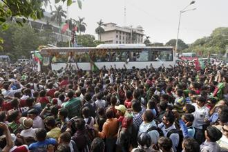 The team which had just ended a 13-year trophy drought was cheered all the way into the city as the players soaked in the applause inside their team bus. Photo: PTI