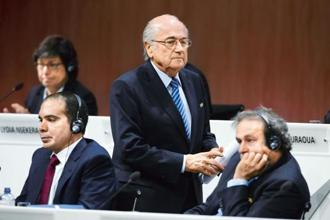 Sepp Blatter (centre) resigned from the post of Fifa president just days after being re-elected. Photo: Fabrice Coffrini/AFP