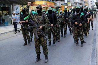 A file photo of Palestinian masked militants of Izzedine al-Qassam Brigades, a military wing of Hamas.