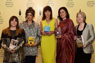 Kamila Shamsie (in sari) with other authors at a photocall for the shortlisted authors for the 2015 Baileys Women's Prize for Fiction award ceremony in London on 3 June, 2015. Photo: AFP