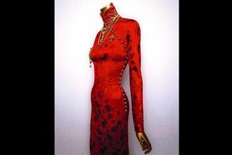 John Galliano's creation in red silk, at the museum in New York. Photo courtesy John Galliano's creationin red silk, at the museum in New York.