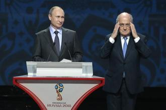 Fifa chief Sepp Blatter (right) with Russian President Vladimir Putin at the preliminary draw for the 2018 soccer World Cup. Photo: AP