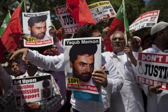 SDPI activists carry placards with photographs of 1993 Mumbai blasts convict Yakub Memon during a protest outside the Maharashtra House demanding abolition of death penalty in New Delhi on 27 July 2015. Photo: AP
