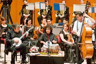 Tabla maestro Zakir Hussain performing a concerto with the Symphony Orchestra Of India in 2013. Photo: Narendra Dangiya