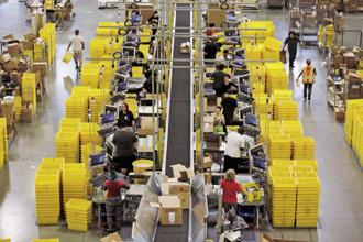 Workers sort products at an Amazon Fulfilment Center in Tracy, California. At the e-commerce giant, workers are encouraged to tear apart one another's ideas in meetings, toil long and late and are held to standards that the company boasts are 'unreasonably high'. Photo: Reuters