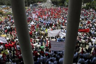 The trade unions claimed that over 15 crore organised sector workers participated in the strike, and media reports suggest banking and transportation services were hit in parts of the country. Photo: AP