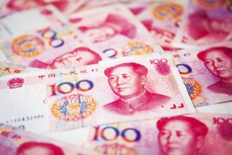 Making the yuan a global currency alongside the dollar and the euro has been a key goal for the government, and removing capital controls is necessary to achieve that. Photo: Bloomberg